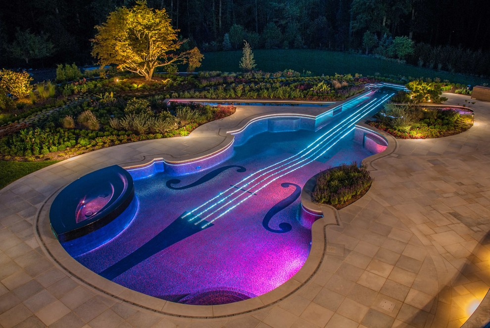 Example of an eclectic backyard custom-shaped hot tub design in New York