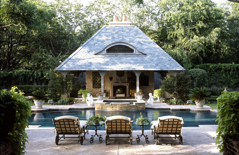 Inspiration for a timeless custom-shaped pool house remodel in Dallas