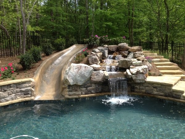 Outdoor pool with slide  Swimming Pool Water Slides - Traditional - Swimming Pool & Hot Tub ...