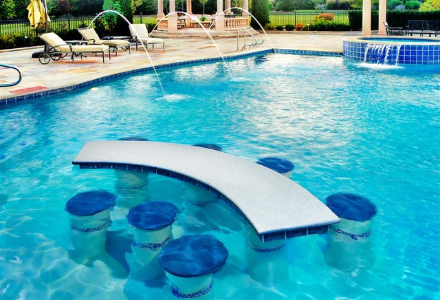 swimming pool with built in seats and table pool