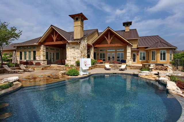 Swimming pools by Stadler Custom Homes traditional-pool