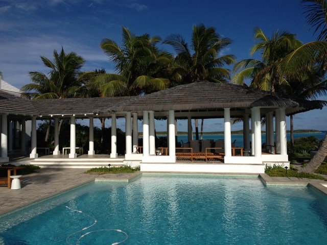 Thatched gazebo in the bahamas tropical pool orange for Pool hut designs