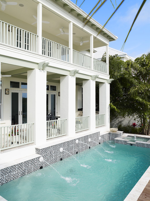 Medium sized world-inspired back rectangular lengths swimming pool in Tampa with a water feature.
