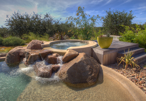 Place large boulders in a poolscape