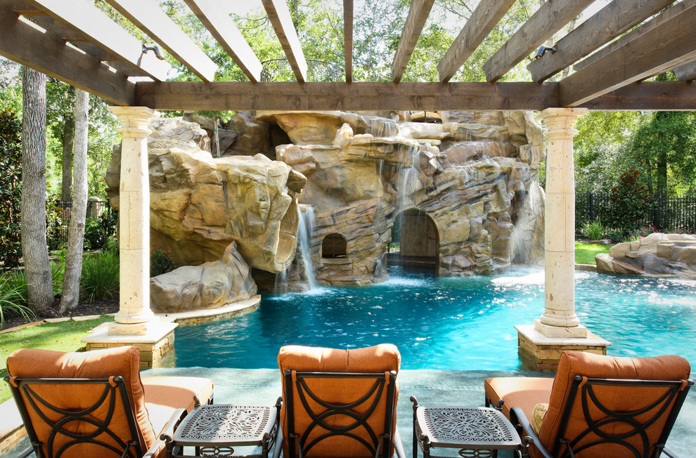 Tuscan backyard custom-shaped natural water slide photo in Houston