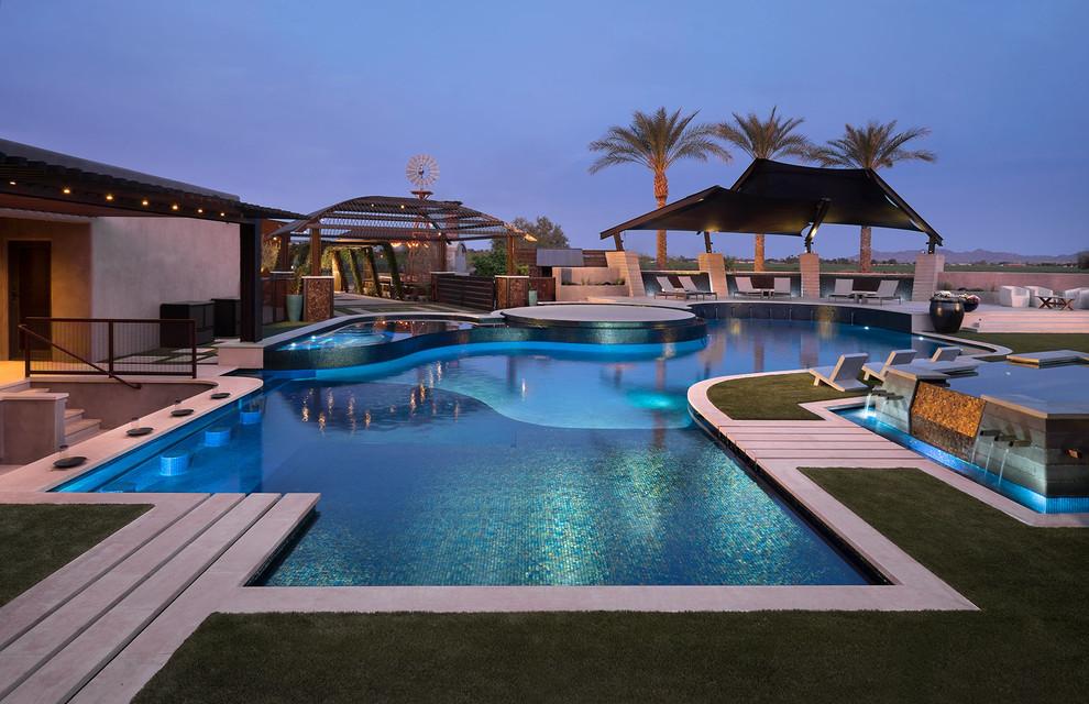 Example of a trendy custom-shaped pool design in Phoenix