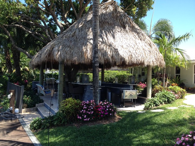 tiki hut outdoor kitchen and landscaping tropical pool miami