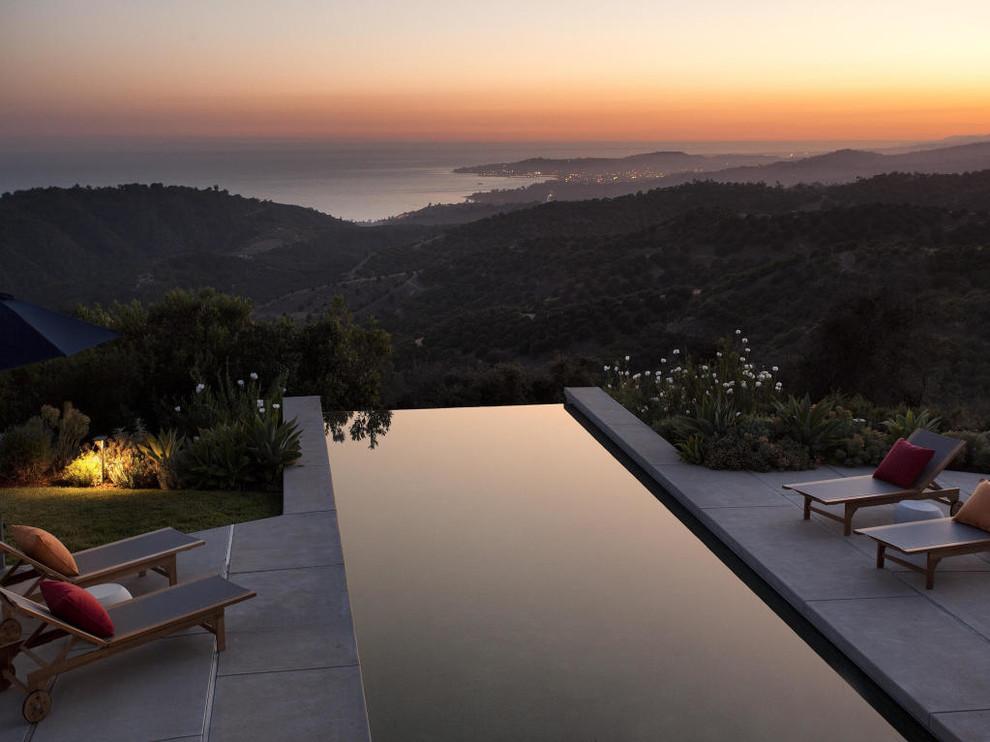 Example of a trendy rectangular infinity pool design in Santa Barbara