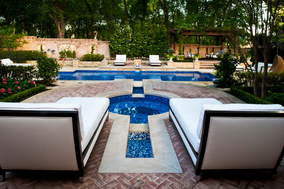 Example of a large classic backyard brick and rectangular lap hot tub design in Dallas