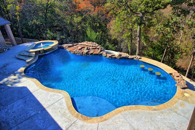 Inspiration for a transitional pool remodel in Dallas
