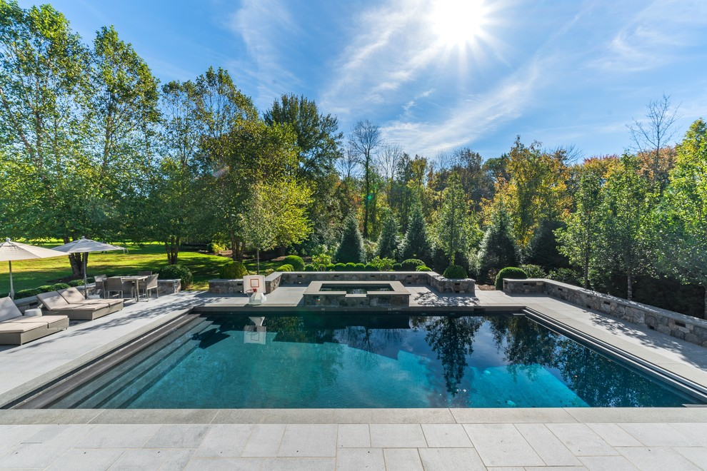 Inspiration for a transitional backyard concrete paver and rectangular lap hot tub remodel in New York