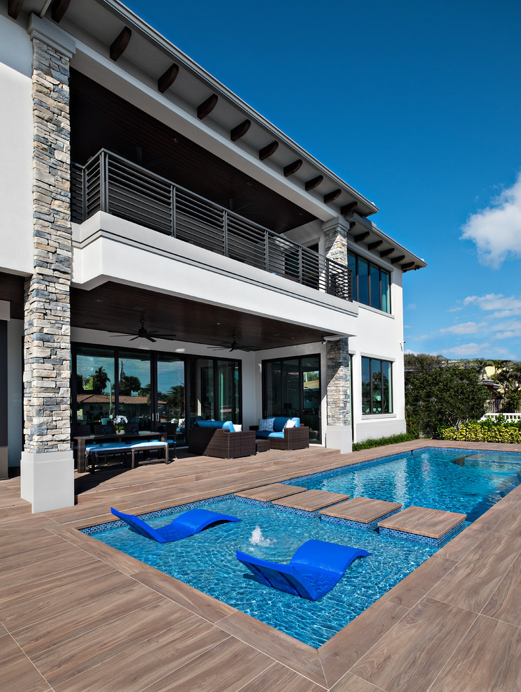 Inspiration for a transitional pool remodel in Miami
