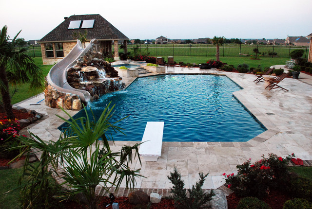 travertine geometric pool with rock slide and grotto traditional pool - Swimming Pools With Grottos
