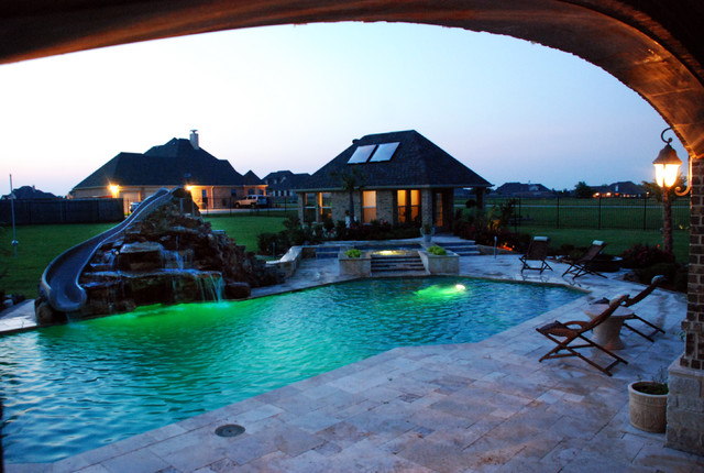Travertine Geometric Pool With Rock Slide And Grotto