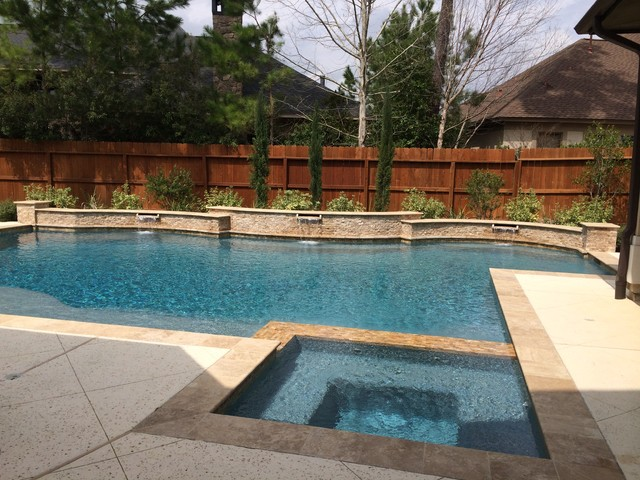 Travertine pool with raised beam wall scuppers for How much does it cost to build a wet bar