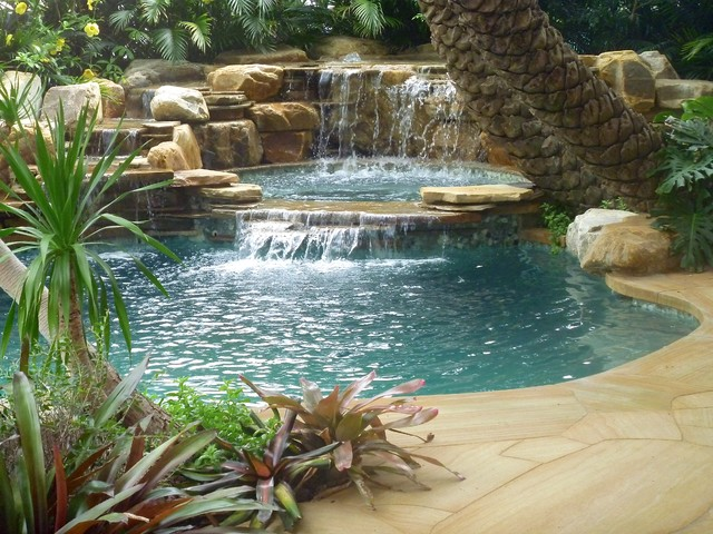 Example Of An Island Style Backyard Stone And Custom Shaped Natural Pool Fountain Design In