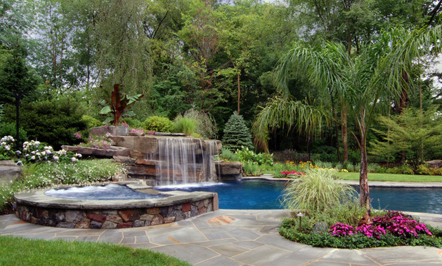 Tropical backyard swimming pool waterfall design bergen for Garden hills pool hours