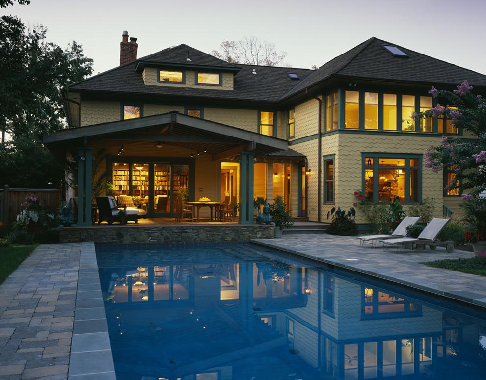 Inspiration for a craftsman backyard brick and rectangular pool remodel in DC Metro