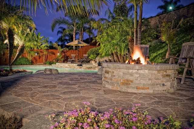 Tropical Pool with firepit and pavers tropical pool