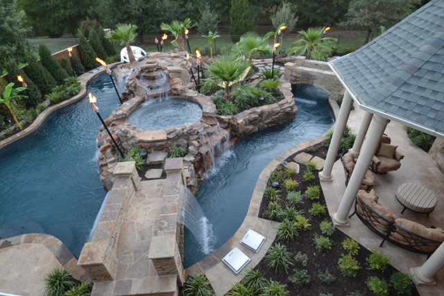 Large Island Style Backyard Stone And Custom Shaped Natural Pool Fountain  Photo In Dallas