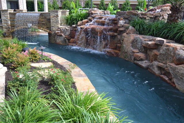 Example Of A Large Island Style Backyard Stone And Custom Shaped Natural  Pool Fountain Design