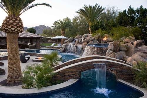 If you create a long and narrow pool that wraps around seating areas, it can act more like a river. This gives the park a more natural appeal and lets your water encompass the area nicely.