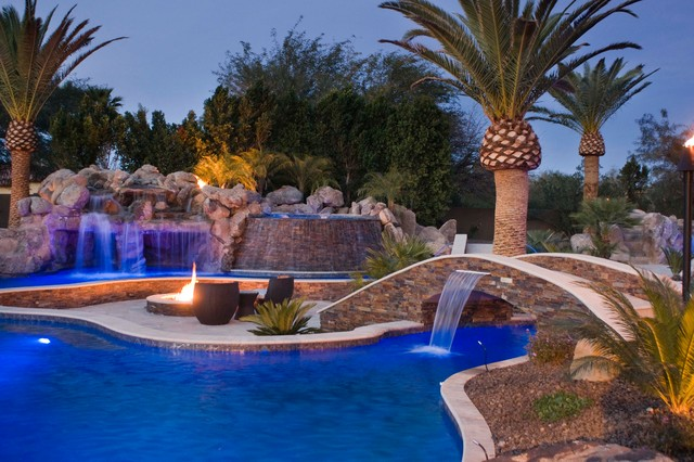 Tropical pool with fire features for Pool design magazine