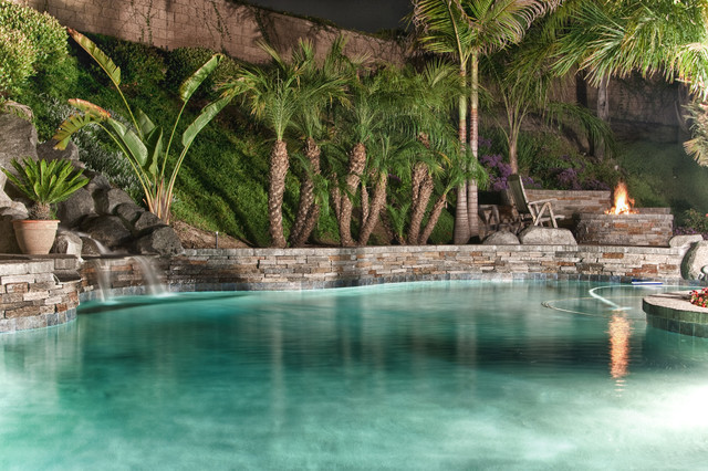 tropical style pool with waterfall firepit. Black Bedroom Furniture Sets. Home Design Ideas