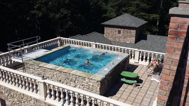 Tuscan style glass bottom rooftop pool mediterranean for Rooftop swimming pool design