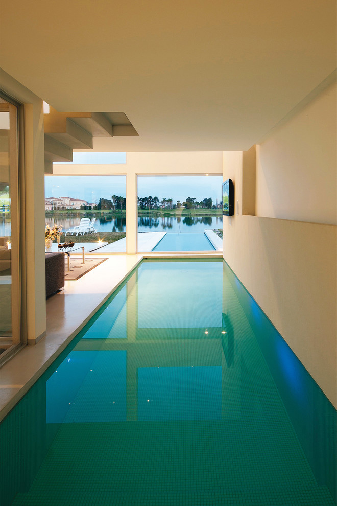 This is an example of a contemporary pool in Other.