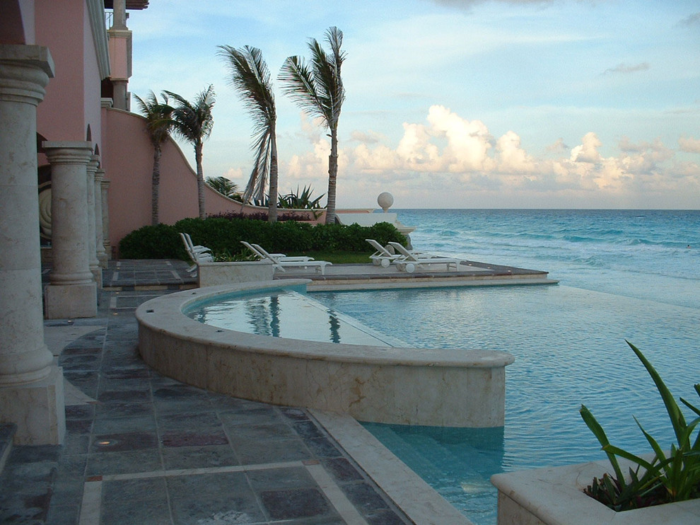 Example of an island style infinity pool design in Other