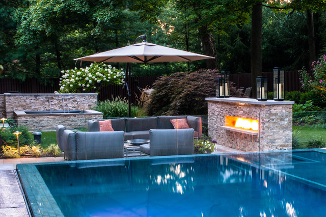 Vanishing edge pool patio fireplace modern pool new for Swimming pool landscaping ideas