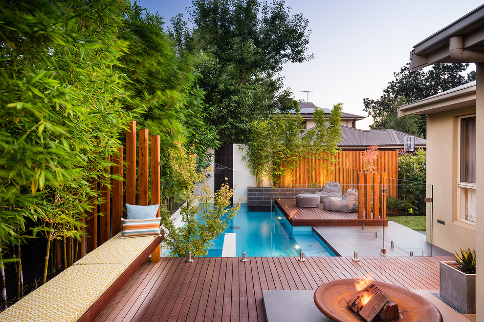 Example of a trendy backyard rectangular pool design in Melbourne with decking