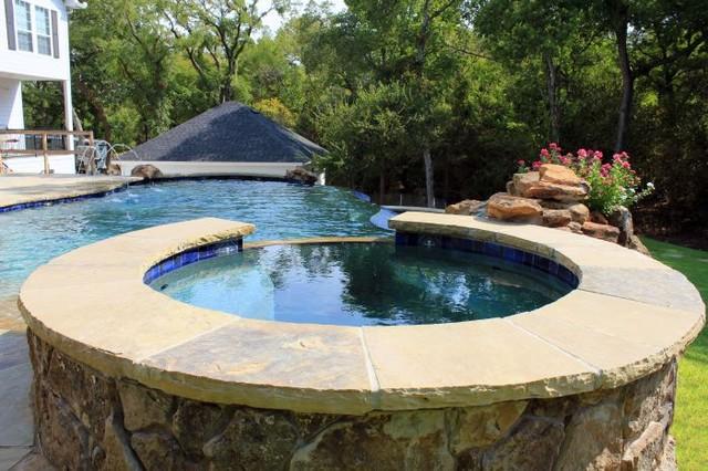 Waco tx wood wheel luxury negative edge swimming pool for Pool design dallas texas