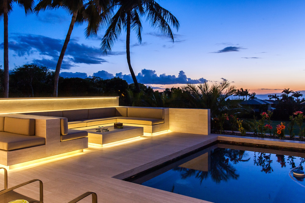 Inspiration for a mid-sized contemporary backyard tile and custom-shaped infinity hot tub remodel in Hawaii