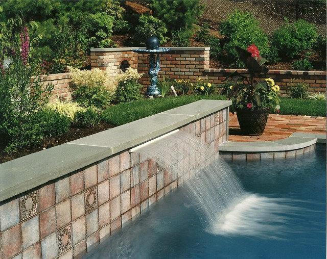 Water Feature On Gunite Pool With Custom Tile And Bluestone Wall Cap