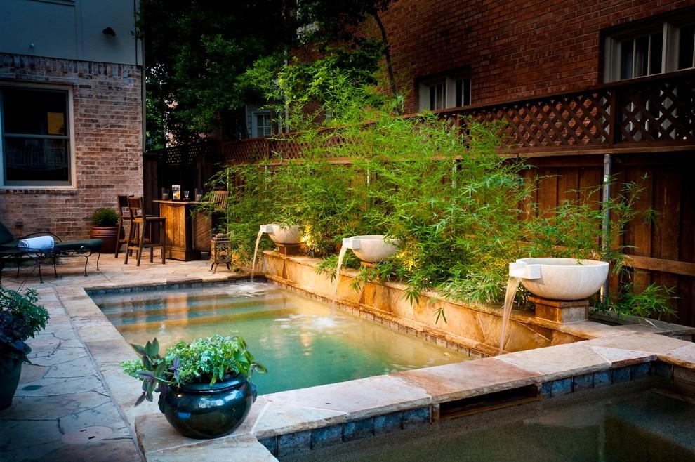 Small elegant backyard rectangular and stone hot tub photo in Dallas