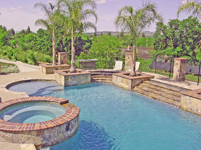 Water slide and fountain swimming pool and retaining for Pool design retaining wall