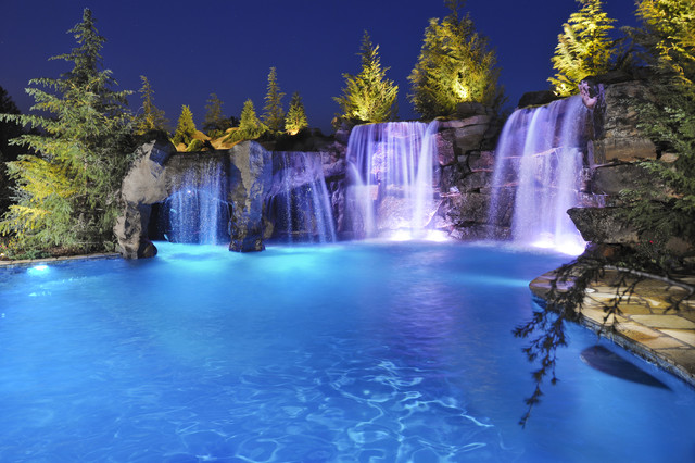 Waterfalls & Grottos Give This Oklahoma Pool Multiple Entertainment Areas - Fami rustic-pool