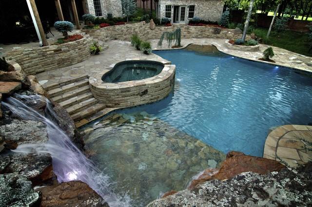 Waterfalls Connect Oklahoma Home to Pool mediterranean-pool