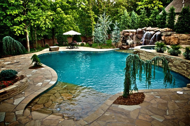 waterfalls connect oklahoma home to pool mediterranean