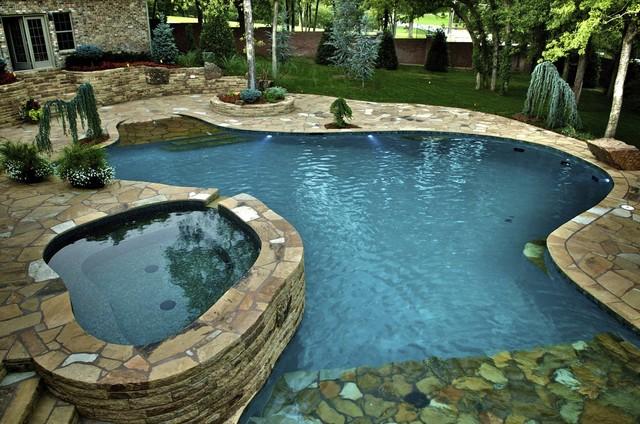 Waterfalls connect oklahoma home to pool mediterran for Pool design okc