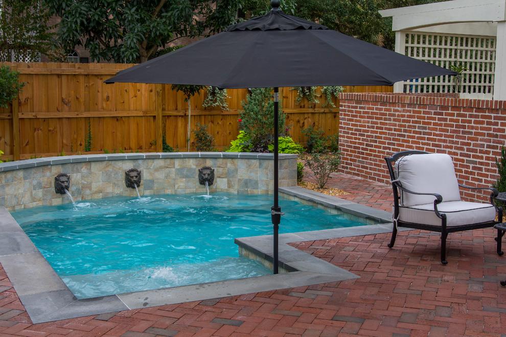 Small elegant backyard brick and custom-shaped natural hot tub photo in Tampa