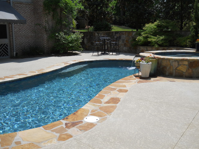 Wet edge prism matrix blue lagoon traditional pool for Garden spas pool germantown tn
