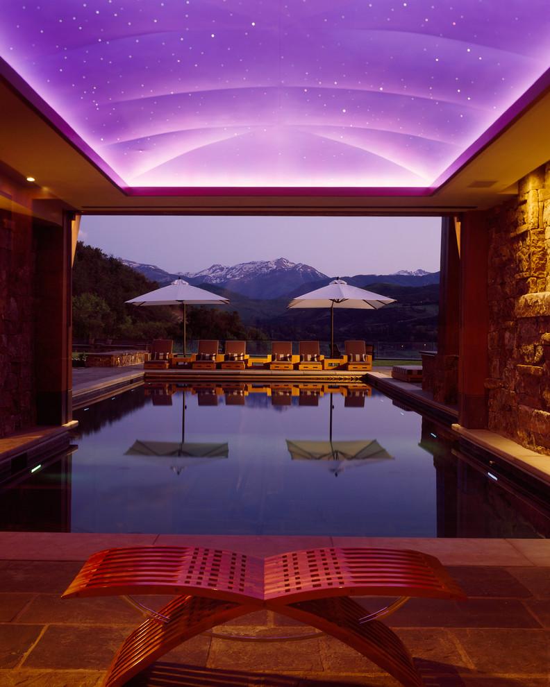 Example of a trendy indoor pool design in Denver
