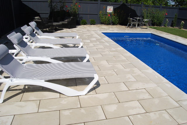 white deck pavers and square edge pool coping