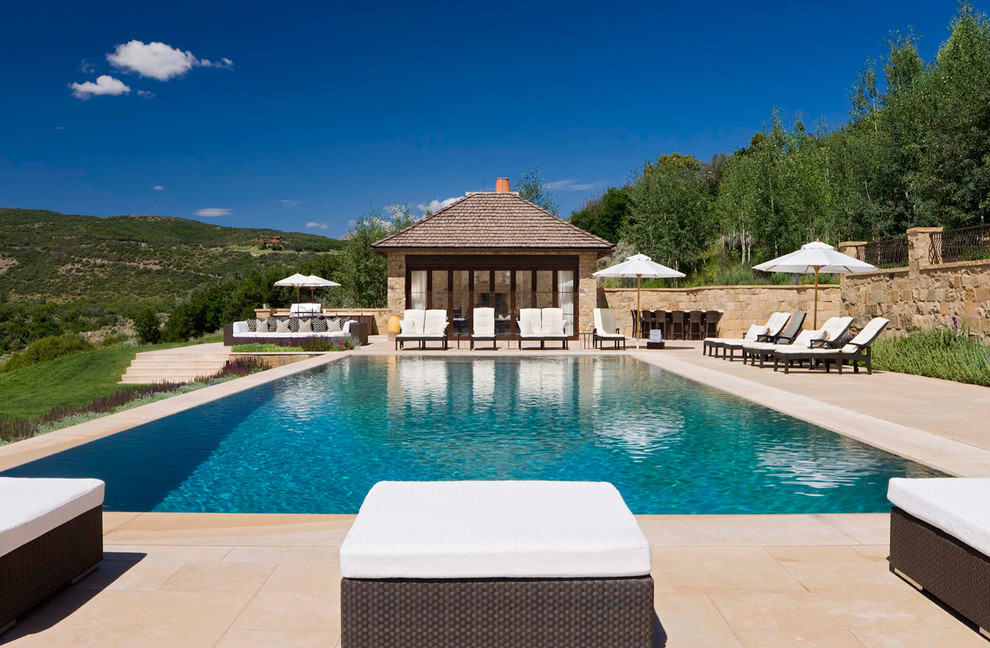 Inspiration for a large timeless backyard rectangular and concrete paver lap pool house remodel in Denver