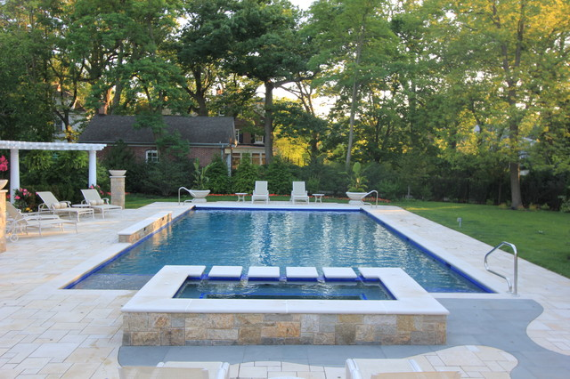 example of a large classic backyard rectangular pool design in chicago