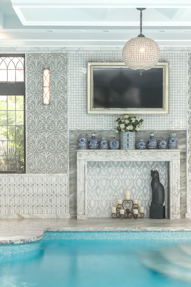 Example of a classic indoor tile pool design in New York
