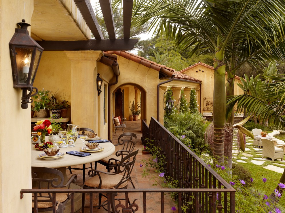 Inspiration for a mid-sized mediterranean tile porch remodel in Other with a roof extension